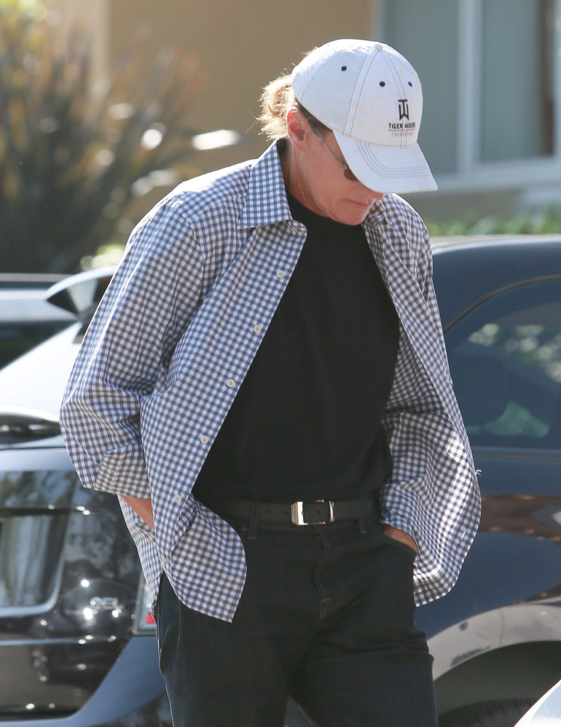 Bruce Jenner covers up as he deals with media scrutiny about his transition (WENN.com)