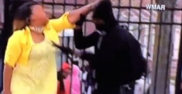 Baltimore Riots: Mom drags her son home