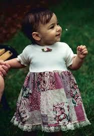 Aly Raisman, foto de infância dois em nbcolympics.com