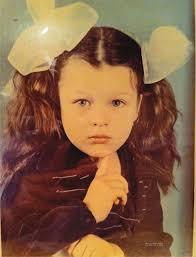 Milla Jovovich childhood photo one at pinterest.com